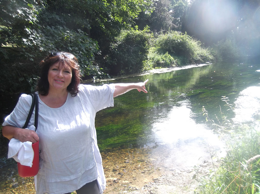 Julie on the banks of the Great Stour River near Chartham - setting for Murder on the Pilgrims Way